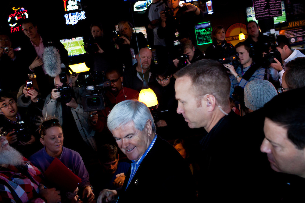 Republican presidential candidate Newt Gingrich meets with voters at the West Towne Pub on Sunday, January 1, 2012 in Ames, IA.
