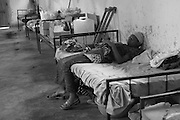 A patient rests on her bed  at CBL Center of Bujumbura ( Center for injured people). @ Martine Perret . 24 October 2005. October 2005.