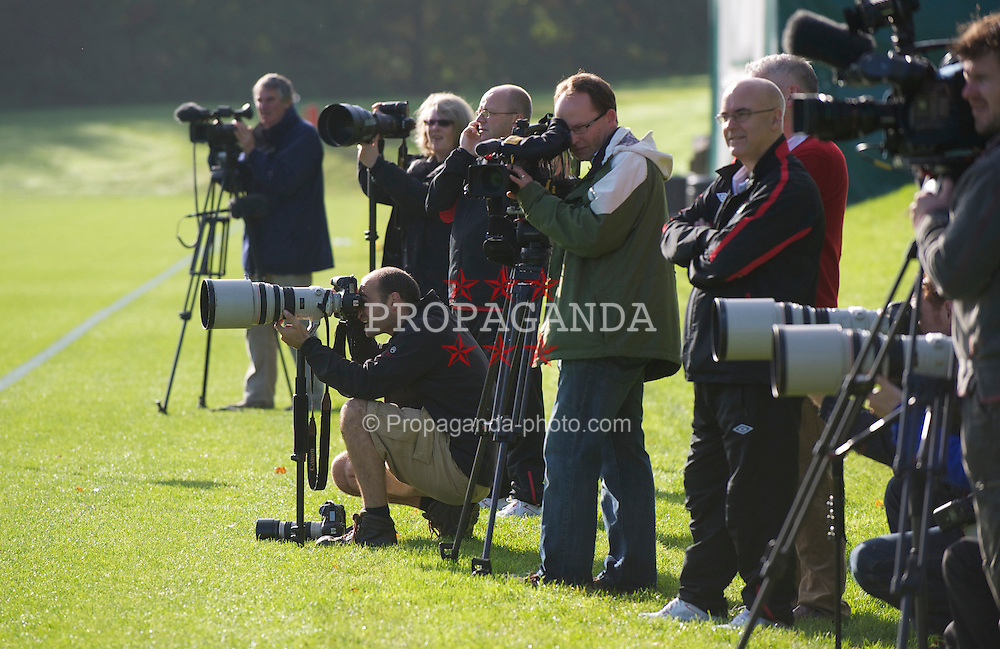 CARDIFF, WALES - Thursday, October 7, 2010: Photographers and television camera men cover the action during a training session at the Vale of Glamorgan ahead of the UEFA Euro 2012 Qualifying Group G match against Bulgaria. (Pic by David Rawcliffe/Propaganda)