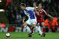 Photo: Paul Thomas.<br /> Blackburn Rovers v SV Red Bell. UEFA Cup. 28/09/2006.<br /> <br /> Morden Gamst Pedersen (L) of Blackburn fights off Christian Tiffert.