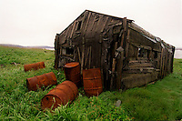 039078.AA.0820.warming27.kc--Bering Sea, Off Providenya, Russia--An old abandoned cabin on whale bone alley. The story deals with the enviromental issue of global warming throughout the region of Russia directly across the Bering Sea from Nome, Alaska. The story touches on the people their way of living, the rough economy and the extent they are effected by the slowly warming temperature as documented by scientists.  More Details To Come.