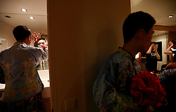 Gay couple Peng Jiajun (L) and Lin Zehao (C) prepare in a cabin room   before a LGBT (lesbian, gay, bisexual and transgender) mass wedding organised by the Parents and Friends of Lesbians and Gays (PFLAG) China organisation on a cruise in open seas on route to Sasebo, Japan, 15 June 2017. About 800 members of the Chinese LGBT (lesbian, gay, bisexual and transgender) community and their parents spent four days on a cruise trip organised by Parents and Friends of Lesbians and Gays (PFLAG) China, a grassroots non-government organisation, celebrating the 10th anniversary of the organisation. It aims to promote coexistence among homosexuals and their families.