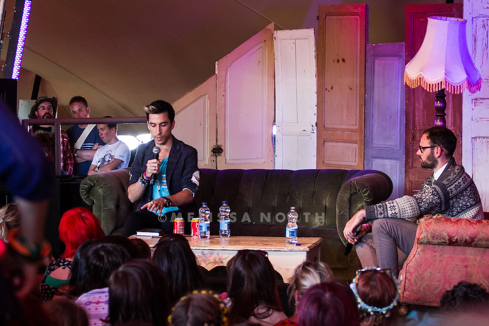 Russell Kane reads from The Humourist in at the East Lulworth Literary Institute tent at Camp Bestival, Lulworth, UK on 29th July 2012. Photo by Melissa North.  Ref B2779