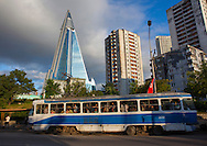 Tramway passing in front of Ryugyong hotel in Pyongyang, North Korea.