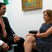 MIAMI, FLORIDA, JULY 6, 2017<br /> ​Abbie Paige, 59, from Lake Worth, is a transgender female who started transitioning from male to female seven years ago.  She has undergone several procedures to live as a female. Here she chats with plastic surgeon  Rian A. Maercks M.D., P.A.<br /> (Photo by Angel Valentin/Freelance)