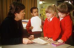 Nursery school teacher with pupils,