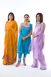 Three women wearing traditional Asian dress,