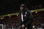 Emmanuel Adebayor watches on from the sidelines during the Barclays Premier League match between Crystal Palace and Bournemouth at Selhurst Park, London, England on 2 February 2016. Photo by Michael Hulf.