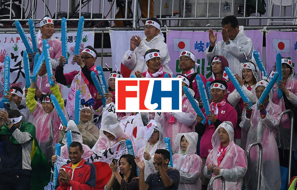 Japans fans cheer during the women's field hockey USA vs Japan match of the Rio 2016 Olympics Games at the Olympic Hockey Centre in Rio de Janeiro on August, 10 2016. / AFP / MANAN VATSYAYANA        (Photo credit should read MANAN VATSYAYANA/AFP/Getty Images)