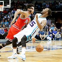 03 November 2015: Chicago Bulls guard Derrick Rose (1) drives past Charlotte Hornets guard Kemba Walker (15) during the Charlotte Hornets  130-105 victory over the Chicago Bulls, at the Time Warner Cable Arena, in Charlotte, North Carolina, USA.