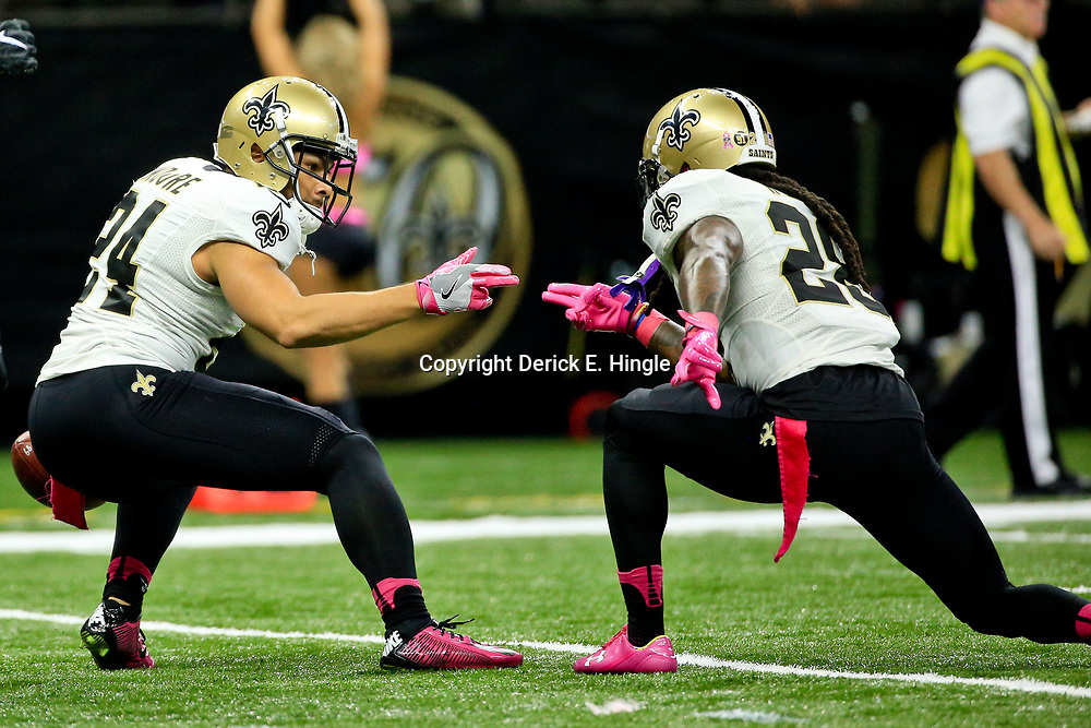 Oct 16, 2016; New Orleans, LA, USA; New Orleans Saints cornerback Sterling Moore (24) celebrates after an interception with cornerback B.W. Webb (28) during the second quarter of a game against the Carolina Panthers at the Mercedes-Benz Superdome. Mandatory Credit: Derick E. Hingle-USA TODAY Sports