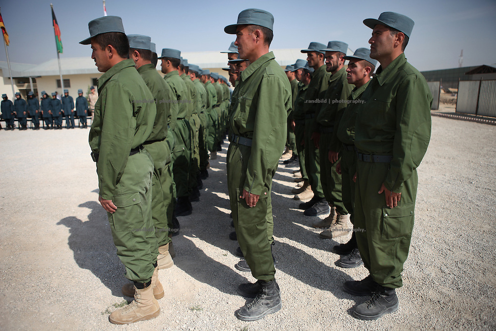 In an official ceremony eleven afghan women recieve their certificates as police officers in Kunudz. They were trained by german, dutch and us-american trainers. The District Police Chief congratulates, as well as all trainers and representatives of ISAF. Male Police recruits stands a formation to greet their female collegues. Female police officers are rare seen in Afghanistan and threaten by islamistic insurgents.