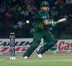 © licensed to London News Pictures. 19/03/2011. Umar Akmal guides a shot through gully during the I.C.C World Cup match between Australia and Pakistan at R.Premadasa Stadium in Colombo, Sri Lanka today (19/03/2011). Photo Credit should read: Asanka Brendon Ratnayake/LNP
