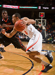 Virginia guard Calvin Baker (4) cuts past Miami (FL) forward Adrian Thomas (30).  The Virginia Cavaliers faced the Miami Hurricanes at the John Paul Jones Arena on the Grounds of the University of Virginia in Charlottesville, VA on February 26, 2009.The Virginia Cavaliers fell to the Miami Hurricanes 62-55 at the John Paul Jones Arena on the Grounds of the University of Virginia in Charlottesville, VA on February 26, 2009.