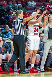 NORMAL, IL - November 20:  Referee Molly Caldwell patrols the sidelines near Megan Talbot and Kristen Gillespie during a college women's basketball game between the ISU Redbirds and the Huskies of Northern Illinois November 20 2019 at Redbird Arena in Normal, IL. (Photo by Alan Look)