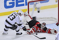 June 9, 2012; Newark, NJ, USA;  New Jersey Devils goalie Martin Brodeur (30) makes a save on Los Angeles Kings right wing Dustin Brown (23) during the first period of Game 5 of the 2012 Stanley Cup Finals at the Prudential Center.