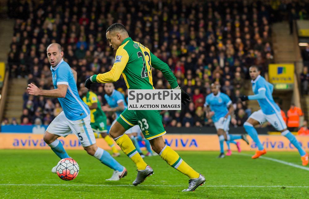 Norwich City defender Martin Olsson (23) passes Manchester City defender Pablo Zabaleta (5)