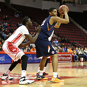 Malcolm Hill #21 of the Illinois Fighting Illini keeps the ball from a member of  the Boston University Terriers during the NIT First Round game at Agganis Arena on March 19, 2014 in Boston, Massachusetts . (Photo by Elan Kawesch)