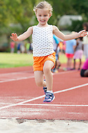 Middletown, New York - Children compete in races during the Twilight Track and Field Series run by the Middletown High School Varsity track program on July 22, 2014.