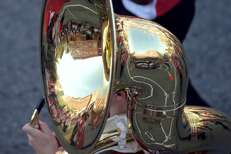 The reflection of downtown Dansville and the Dogwood Parade lines a tuba from a member of the Dansville Marching Mustangs during this past Saturday's parade