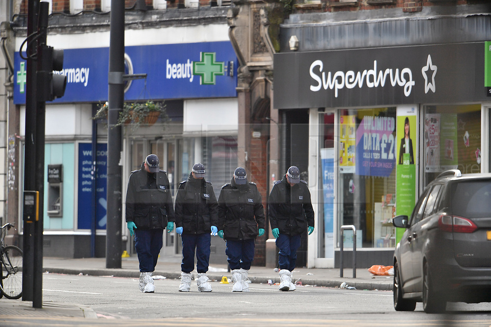 © Licensed to London News Pictures. 03/02/2020. London, UK. A police search team looks for evidence in front of Boots and Superdrug at scene of yesterday's terrorist attack, on Streatham High Road in south London. A man, named as Sudesh Amman, was shot dead by police yesterday after a number of people were stabbed on Streatham High Road. Metropolitan Police declared the incident terrorist-related. Photo credit: Ben Cawthra/LNP