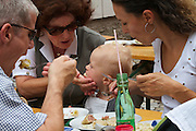 Kärntnernudelfest (Carinthian Dumplings Festival) in Oberdrauburg 2011. A little visitor having fun with his noodles.