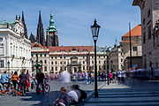 """Tourist at """"Hradcany Square"""" (Hradcanske Namesti) which is leading to the first courtyard of Prague Castle."""