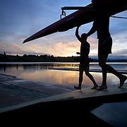 Rowers prepare to train at dawn on Lake Karapiro, near Cambridge, Waikato. Many national and international rowing competitions are held on Lake Karapiro which is also the home of The Rowing New Zealand High Performance Centre. Lake Karapiro hosted the 2010 World Rowing Championships. Lake Karapiro, Waikato,  New Zealand. 15th December 2010. Photo Tim Clayton
