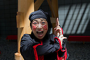 Portrait of an actress dressed as a ninja during the Edo festival at Haneda International Airport terminal, Tokyo, Japan. Friday August 26th 2016. The 3 day festival runs from August 26th to August 28th at Tokyo's second International airport. Actors dressed as samurai, geisha and ninja will greet passengers and visitors to the terminal and put on shows and parades of traditional music and dance. Haneda International airport has an Edo theme. Edo is the old name for Tokyo in the time of the samurai