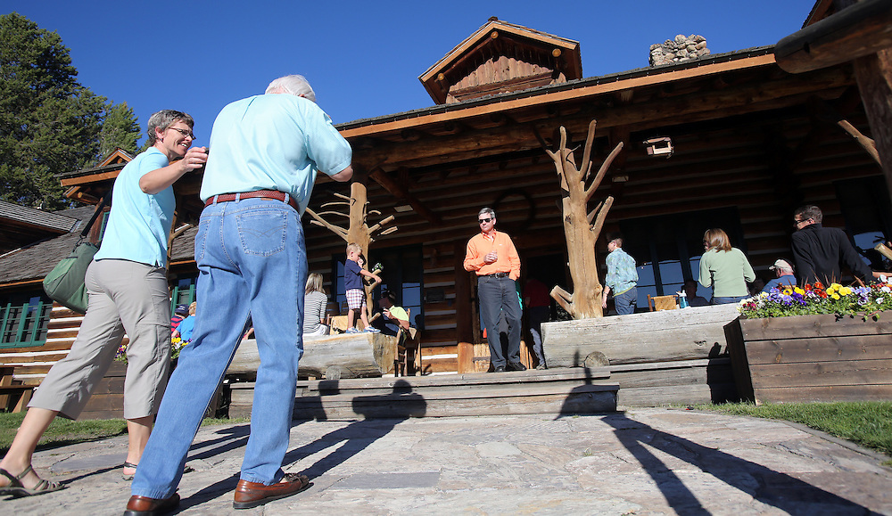 Guests arrive at the Idaho Rocky Mountain Lodge for dinner on Saturday July 13, 2013, in the Sawtooth Mountains in central Idaho south of the town of Stanley.