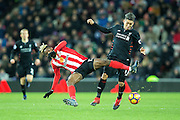 Liverpool forward Roberto Firmino (#11) wins the battle for the ball with Sunderland midfielder Didier Ndong (#17) during the Premier League match between Sunderland and Liverpool at the Stadium Of Light, Sunderland, England on 2 January 2017. Photo by Craig Doyle.
