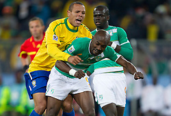 Luis Fabiano of Brazil vs Didier Zokora of Ivory Coast during the 2010 FIFA World Cup South Africa Group G Second Round match between Brazil and République de Côte d'Ivoire on June 20, 2010 at Soccer City Stadium in Soweto, suburban Johannesburg, South Africa.  Brazil defeated Ivory Coast 3-1. (Photo by Vid Ponikvar / Sportida)