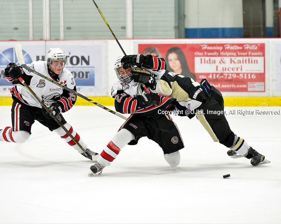GEORGETOWN, ON - Apr 16, 2016 -  Ontario Junior Hockey League game action between Trenton Golden Hawks and the Georgetown Raiders. Game 2 of the Buckland Cup Championship Series, Jack Jacome #23 of the Georgetown Raiders attempts to get past Brandon Marinelli #7 of the Trenton Golden Hawks while pursing the puck at the Gordon Alcott Memorial Arena in Georgetown, Ontario. <br /> (Photo by Shawn Muir / OJHL Images)