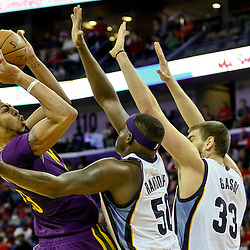 Feb 1, 2016; New Orleans, LA, USA; New Orleans Pelicans forward Anthony Davis (23) shoots over Memphis Grizzlies forward Zach Randolph (50) and Memphis Grizzlies center Marc Gasol (33) during the second half of a game at the Smoothie King Center. The Grizzlies defeated the Pelicans 110-95. Mandatory Credit: Derick E. Hingle-USA TODAY Sports