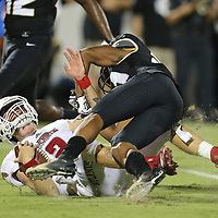 ORLANDO, FL - SEPTEMBER 21:  Rashard Causey #21 of the UCF Knights hits Chris Robison #2 of the Florida Atlantic Owls during a game at Spectrum Stadium on September 21, 2018 in Orlando, Florida. (Photo by Alex Menendez/Getty Images) *** Local Caption *** Rashard Causey; Chris Robison