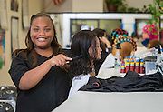 Sam Houston High School student Maia Smith poses for a photograph in a cosmotology class at the Barbara Jordan High School for Careers, November 21, 2016.