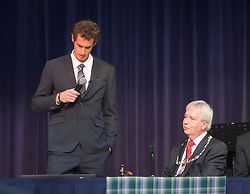 Andy break during his short speech. Andy Murray received the Freedom of Stirling from Stirling Council, who have recognised the Wimbledon champion's sporting achievements at a special council meeting at Dunblane High School.<br />