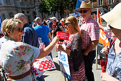 © Licensed to London News Pictures. 30/06/2018. London, UK. Stickers and flags being handed out as Thousands of people take part in a march through central London to mark the 70th anniversary of the NHS. The UK's National Health Service was launched on July 5th, 1948 as part of major social reforms following the Second World War. Photo credit: Ben Cawthra/LNP