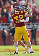 November 06 2010: Iowa State Cyclones kicker Grant Mahoney (21) is congratulated by Iowa State Cyclones running back Jeff Woody (32)  after his 57 yard field goal during the first half of the NCAA football game between the Nebraska Cornhuskers and the Iowa State Cyclones at Jack Trice Stadium in Ames, Iowa on Saturday November 6, 2010. Nebraska defeated Iowa State 31-30.