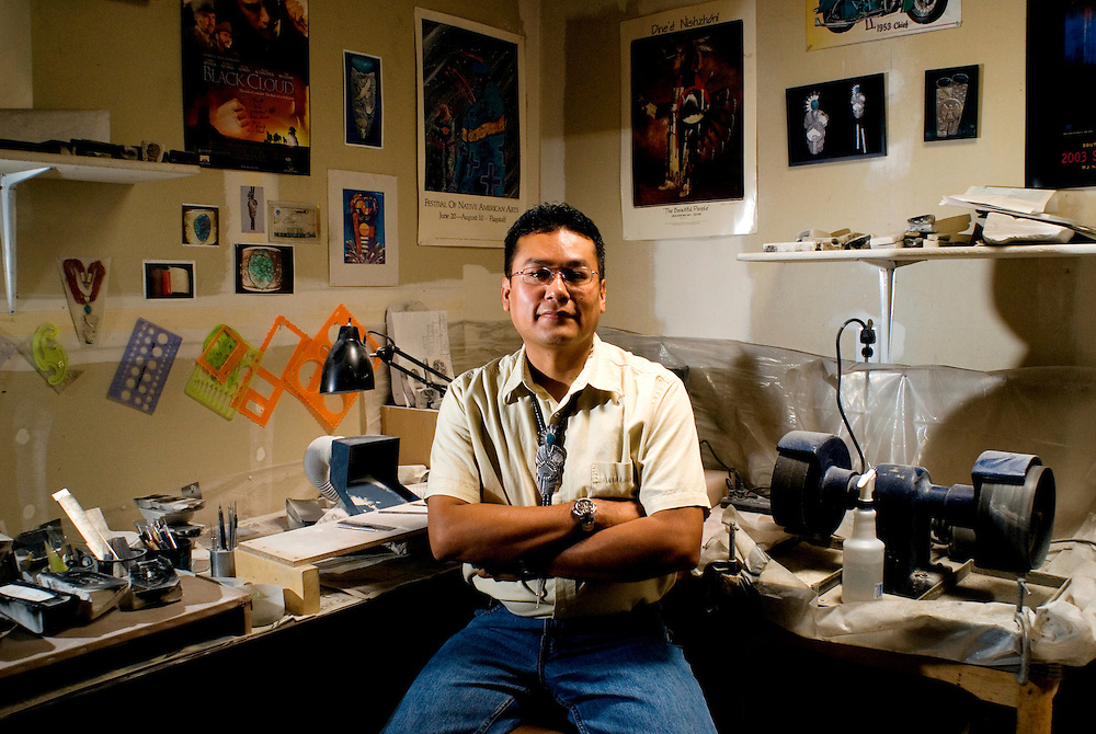 Navajo tufa casting artist Darryl D. Begay poses in his studio at his home in Gallup, New Mexico. Tufa casting was one of the first techniques adopted by modern Navajo artist due to it's simplicity. Begay, who is considered one of the best, uses the technique to make jewelry similar to which he is wearing.