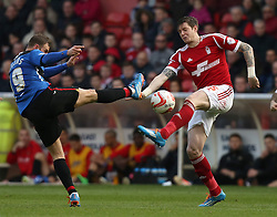 Nottingham Forest's Greg Halford and Doncaster's Richie Wellens battle for the ball - Photo mandatory by-line: Matt Bunn/JMP - Tel: Mobile: 07966 386802 15/03/2014 - SPORT - FOOTBALL - City Ground - Nottingham - Nottingham Forest v Doncaster Rovers - Sky Bet Championship