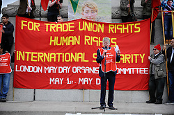 © Licensed to London News Pictures. 01/05/2018. LONDON, UK.  An organiser addresses demonstrators during the annual May Day Rally on International Workers' Day, having marched through central London to a rally in Trafalgar Square.  Photo credit: Stephen Chung/LNP