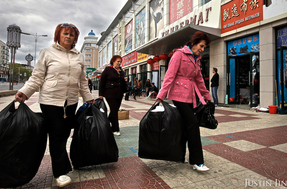 Russian women from Khabarovsk city on a shopping spree  in Fuyuan town in China, just across the Amur River that separates Russia and China. Prices for goods and services are much lower in China.