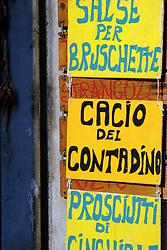 Castiglione del Lago:  A foods shop advertises its wares.