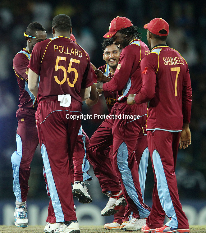 Chris Gayle of The West Indies and team mates celebrate the win during the ICC World Twenty20 semi final match between Australia and The West Indies held at the Premadasa Stadium in Colombo, Sri Lanka on the 5th October 2012<br /> <br /> Photo by Ron Gaunt/SPORTZPICS