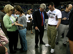 12 March, 2006. New Orleans, Louisiana. <br /> Praising the Lord. A capacity crowd mingles with counselors in front of the pulpit at the last appearance from the Rev Billy Graham. Claiming this to be his last event preaching from the pulpit, the world's most famous evangelist, The Reverend Billy Graham addressed a capacity crowd at the New Orleans Arena as he brings his 'Celebration of Hope' weekend event to an end. After the show the counselors invite as many people as possible to invite Jesus into their hearts to be 'saved.' Proselytizing is intense.<br /> Photo©; Charlie Varley/varleypix.com