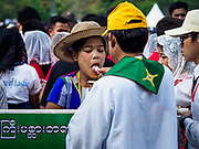 29 NOVEMBER 2017 - YANGON, MYANMAR:  A woman accepts communion during the Papal Mass in Yangon. Hundreds of thousands of Catholics from Myanmar attended the mass said by Pope Francis at Kyaikkasan Sports Ground in Yangon Wednesday. Pope Francis is on the first visit by a Pope to Myanmar.   PHOTO BY JACK KURTZ
