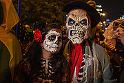 New York, NY, October 31, 2013.  A woman in catrina costume and a man in ghoulish skeleton costumer in the Greenwich Village Halloween Parade.