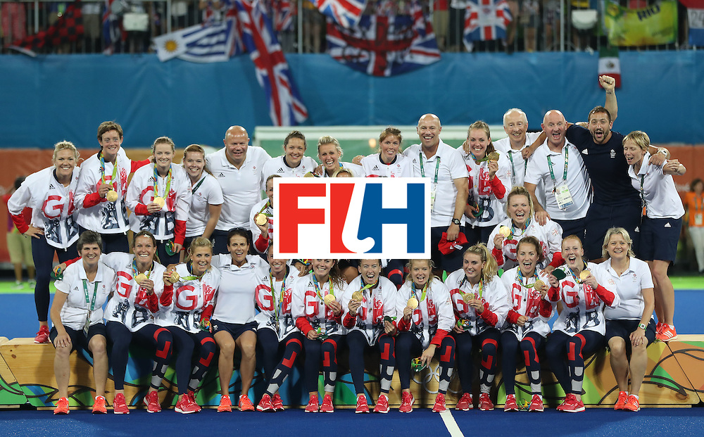RIO DE JANEIRO, BRAZIL - AUGUST 19:  Great Britain pose on the podium after winning a penalty shoot out during the Women's Hockey final between Great Britain and the Netherlands on day 14 at Olympic Hockey Centre on August 19, 2016 in Rio de Janeiro, Brazil. (Photo by Ian MacNicol/Getty Images)