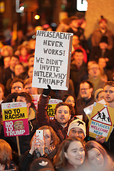 © Licensed to London News Pictures . 30/01/2017 . Manchester , UK . People at a demonstration against America's Muslim travel ban , the UK's alignment with the Donald Trump administration and a possible State visit to the UK by Trump - outside Manchester Town Hall , in Albert Square , central Manchester . Photo credit : Joel Goodman/LNP